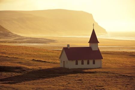 evening church: Typical Rural Icelandic Church at Sea Coastline. Horizontal shot  Stock Photo