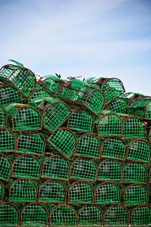 Lobster and Crab traps stack in a port. Vertical shot photo