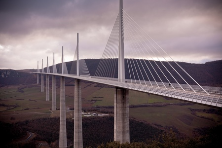 The Millau Viaduct is a motorway bridge which spans the River Tarn valley near Millau in France photo