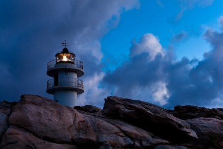 Working Lighthouse at Bad Weather. Horizontal shot Stock Photo