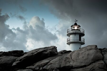 Working Lighthouse at Northern Spain in Bad Weather. Horizontal shot photo