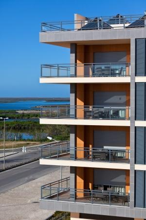New Resort Apartment House against bright blue sky. Vertical shot