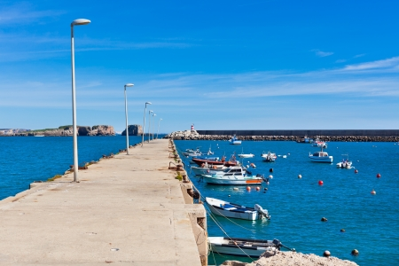 Old Pier with Boats at Sagres, Portugal. Sunny day