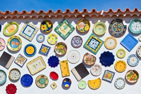 Traditional portuguese pottery plates on a wall in Algarve Coast, Portugal