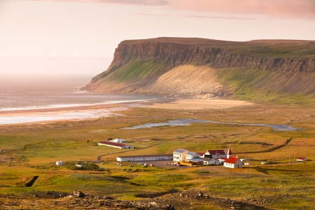 Icelandic Landscape with small Location  Breidavik  at Ocean Coastline photo