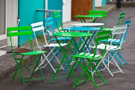 portative: Bright Multicolor Cafe Tables and Chairs at Reykjavik Harbor