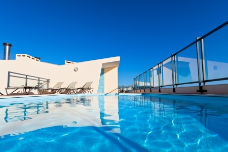 Apartment house with outdoor swimming pool at the roof  Horizontal shot photo
