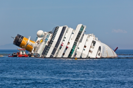 GIGLIO, ITALY - APRIL 28, 2012  Costa Concordia Cruise Ship at Italian Giglio Island Coastline after Shipwreck at January, 13, 2012  The ship, carrying 4,252 people from all over the world, was on the first leg of a cruise around the Mediterranean Sea, st Editorial