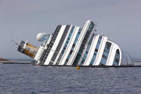 28: GIGLIO, ITALY - APRIL 28, 2012  Costa Concordia Cruise Ship at Italian Giglio Island Coastline after Shipwreck at January, 13, 2012  The ship, carrying 4,252 people from all over the world, was on the first leg of a cruise around the Mediterranean Sea, st Editorial