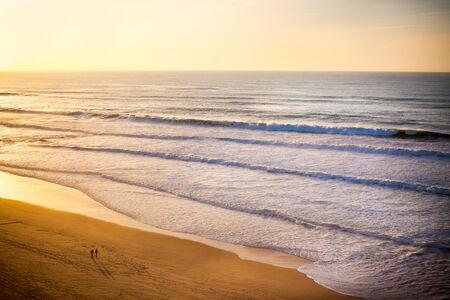 Beautiful orange sunset on the ocean shore  Portugal coast Stock Photo - 24991591