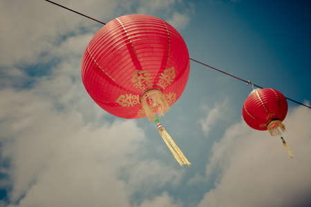 Red Chinese Paper Lanterns against a Blue Sky  Horizontal shot photo