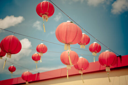 Red Chinese Paper Lanterns against a Blue Sky  Horizontal filtered shot photo