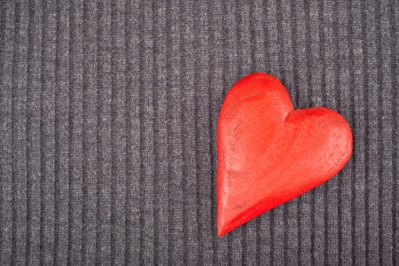 Red Wooden Heart on Knitted Background  Copy Space  Toned Image photo
