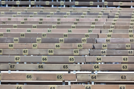 grandstand: Wooden Grandstand Seats with Numbers  Horizontal shot