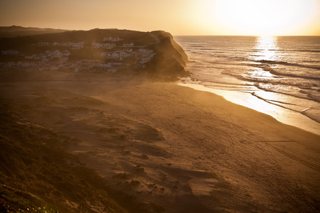 Beautiful orange sunset on the Portugal ocean coast photo