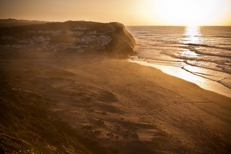 Beautiful orange sunset on the Portugal ocean coast photo
