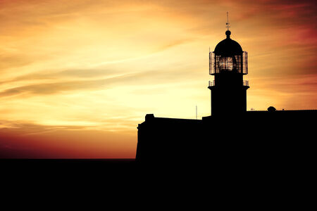Lighthouse of Cabo Sao Vicente, Sagres, Portugal at Sunset - Farol do Cabo Sao Vicente  built in october 1851  photo