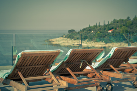 Hotel Poolside Chairs with Sea view  Horizontal vintage style shot photo