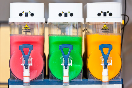 non alcoholic beverage: Crushed Fruit Ice Drink Dispensers with Color Refreshments Stock Photo