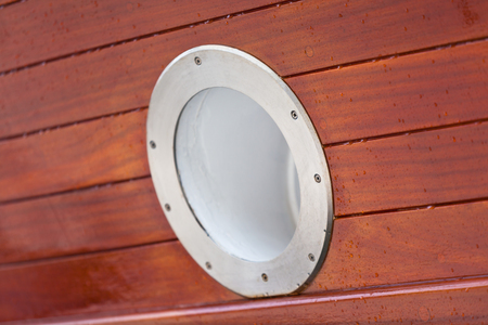 ship porthole: Wooden Ship porthole  View from outside  Copy space