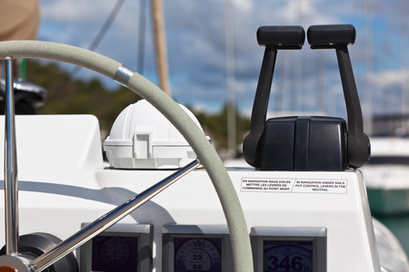 Sailing yacht control wheel and implement  Horizontal shot without people photo
