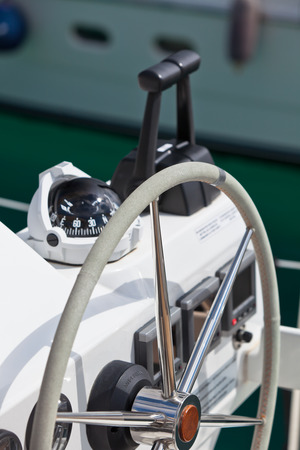 Sailing yacht control wheel and implement  Vertical shot without people photo