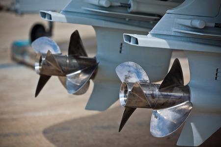motor yacht: Two motor boat screws  Horizontal day shot