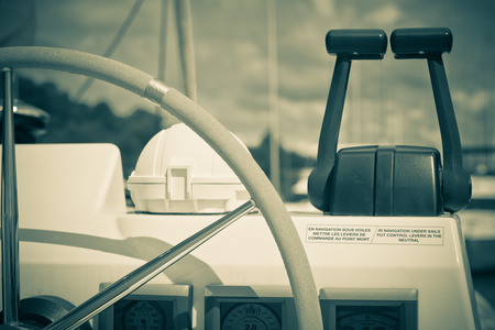 Sailing yacht control wheel and implement  Horizontal filtered shot without people photo