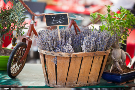 Lavender bunches selling in a outdoor french market. Horizontal shot with selective focus photo