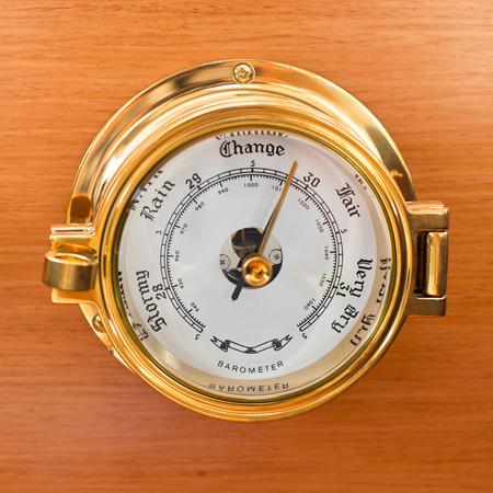 Yacht Barometer Close Up shot on wooden background photo