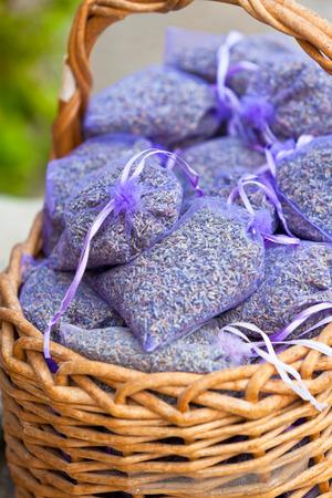 sachets: Dried lavender sachets basket. Vertical shot Stock Photo