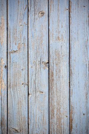 vignetted: Blue wooden planks surface background. Vertical vignetted shot