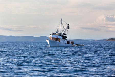 Old fishing boat in the Adriatic sea. Horizontal shot
