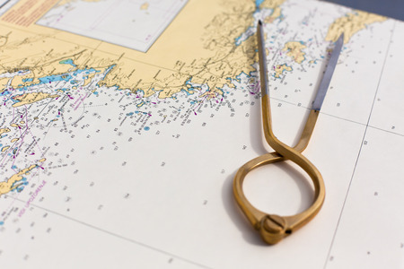 navigational: Pair of compasses for navigation on a sea map with low depth of field Stock Photo