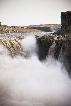 waterfall  dirty: Dettifoss Waterfall in Iceland at overcast weather. Vertical shot Stock Photo