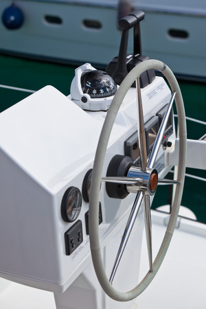 Sailing yacht control wheel and implement. Vertical shot without people photo