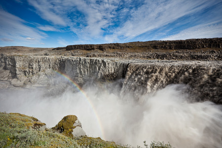 waterfall  dirty: Dettifoss Waterfall in Iceland under a blue summer sky with clouds. Horizontal shot Stock Photo
