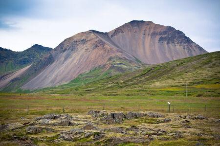 caked: Iceland Caked Lava field and mountains landscape. Horizontal shot Stock Photo