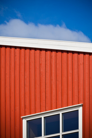 vignetted: Geometrical shot of house wall on sky background. Vignetted image Stock Photo