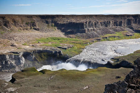 waterfall  dirty: Dettifoss Waterfall in Iceland under a blue summer sky with clouds.  Stock Photo