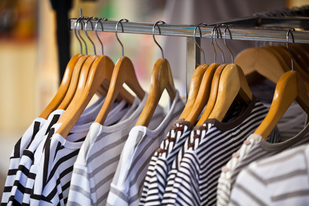 pullovers: Striped Female Pullovers in a Clothing Store. CloseUp shot with small GRIP