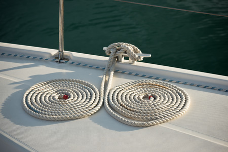 cleat: A mooring ropes with a knotted ends tied around a cleat