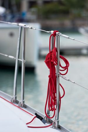 lifeline: A red rope tied around a lifeline. Vertical shot Stock Photo