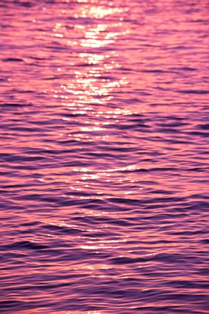 Blur background of the water surface. Vertical filtered defocused shot photo