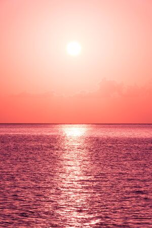 filtered: Beautiful tropical sunset ocean background. Fantasy filtered shot