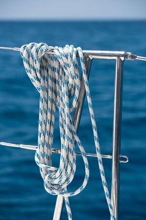 lifeline: A rope tied around a lifeline on a yacht. Ocean background
