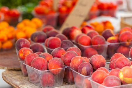 peach: Ripe fresh peaches in a farmers market. Horizontal shot with a selective focus Stock Photo