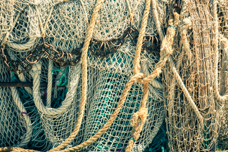 trawl: Old fishing nets and ropes. Filtered shot Stock Photo