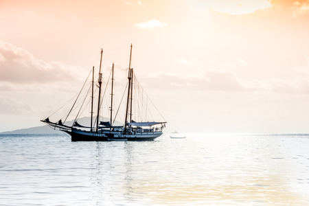 indian ocean: Recreational Yacht at the Indian Ocean. Beautiful pastel sunrise