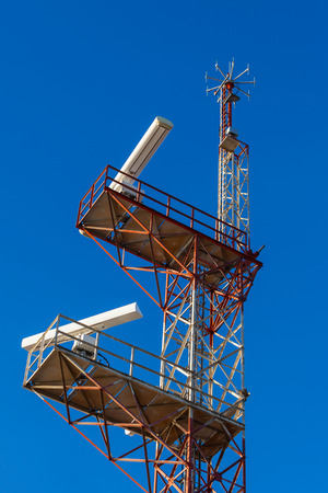 communication tower: A navigation communication tower against a blue sky Stock Photo